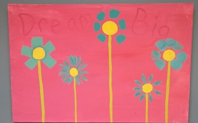 "Painted picture of flowers with statement ""Dream Big"""
