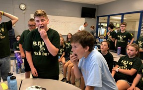 Students tasting food on field day