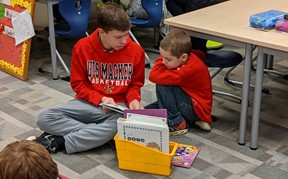 Students reading books together