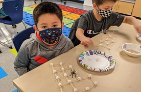 Student with marshmallow spiderweb