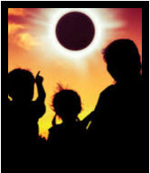 Parent and children watching eclipse